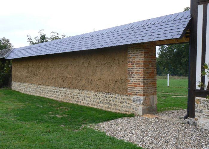 mur en terre crue Normandie