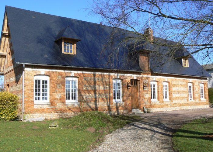Rénovation façade de brique et silex en Normandie